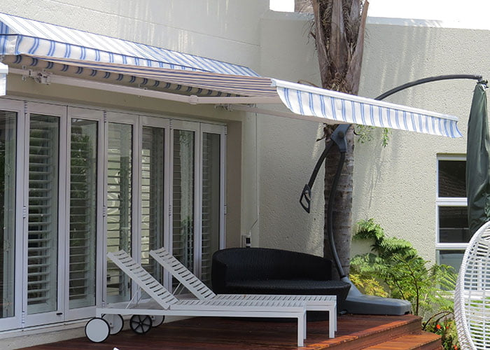 retractable fold arm awnings
